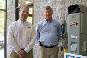 In 2004, Matt Hyde talked his father Ken into coming out of retirement so the two could start their new business Phoenix Energy. The company recently moved to Pell City. The two men stand next to a natural gas fueling station at their new store in Pell City. Brian Schoenhals/The Daily Home